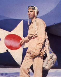 Lt. Edward O'Hare stands beside a F4F-3 Wildcat (note leather cowboy belt instead of GI standard issue tan military web belt).