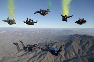 Skydiving team descending.